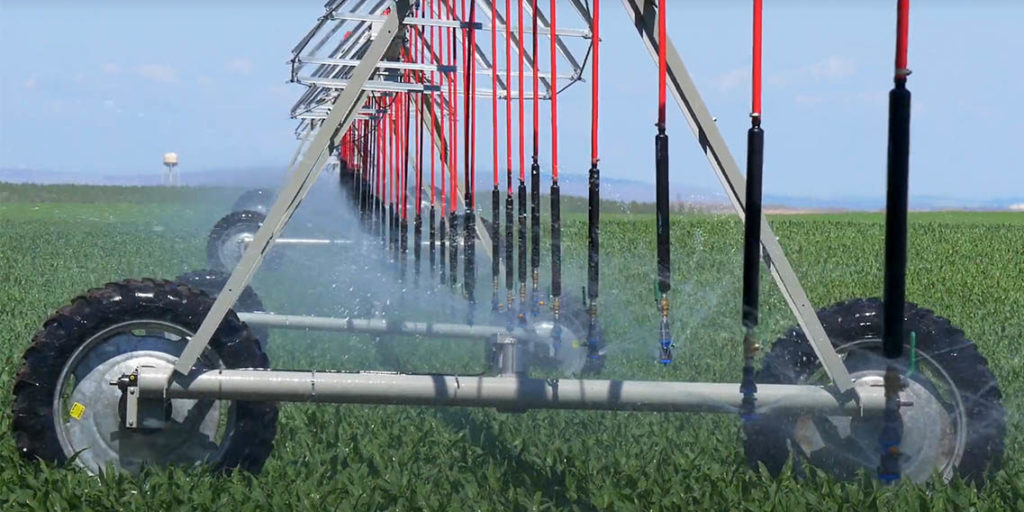 Watering crops using conservation methods
